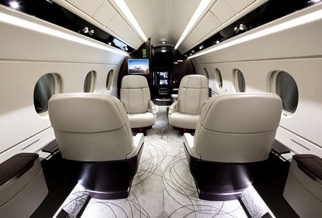 Cabin of the Legacy 450 for charter by Solairus Aviation