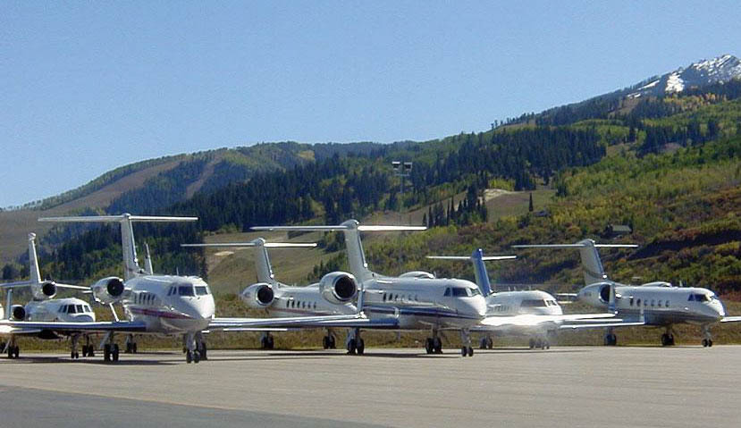 Large-cabin Gulfstream, Challenger and Falcon jets on the ramp at Aspen-Pitkin County Airport.